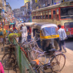 The traffic on the streets of Pune is busy with rickshaws, bicycles, buses and pedestrians. Photo by wili_hybrid.