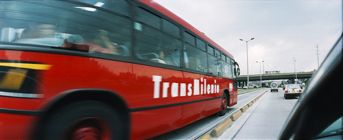 A Transmilenio bus rolls smoothly into Bogota. Photo by adrimcm.