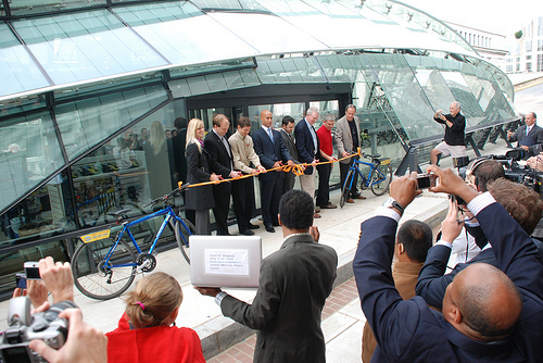 Mayor Fenty leads the ribbon cutting to unveil Bikestation's newest facility. Photo by Rhys Thom.