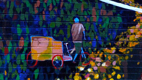 Details of a pedicab mural. Photo by Nate Baird.