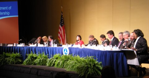 Peter Rogoff, FTA Administrator, teases Cynthia Quarterman, Pipeline and Hazardous Materials Safety Administrator, for arriving late to the panel because she was stuck in traffic and didn't use public transportation. Photo by Megan McConville.