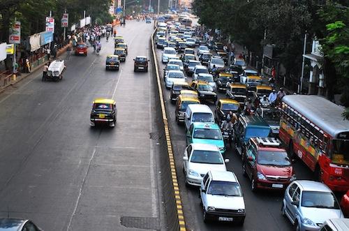 Evening rush hour traffic outside the Chhatrapati Shivaji Terminus in Mumbai. Photo by Vikas Hotwani.