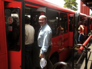 Councilmember George Leventhal enters a bi-articulated express bus in Curitiba. Photo via Maryland Politics Watch.