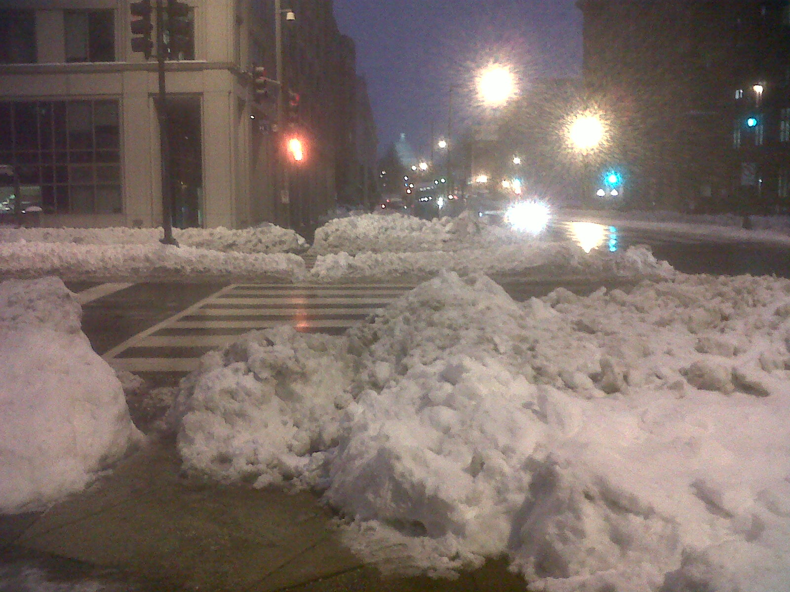 Snow drifts make it dangerous to cross busy intersections, seen here at North Capitol and H. Photo by Allison Bishins.