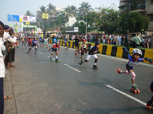 In addition to rollerskating, children were seen biking, running, walking and playing along car-free streets, far from pollution and air-conditioning. Photo by Madhav Pai.