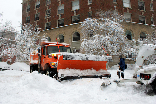 A snow plow gets towed in the aftermath of the blizzard. Photo by theqspeaks.
