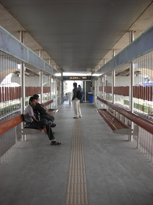 After consulting with the Blind Peoples' Association, Ahmedabad's BRT planners incorporated tactile tiles to guide visually impaired users through the stations. Photo by Prajna Rao.