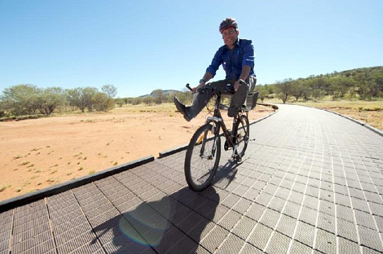 Australia's Parks and Wildlife Minister Karl Hampton tests the new bike path. Photo via The Centralian Advocate.