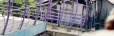 At Vidyavihar railway station, Central Railway authorities blocked the MMRDA's new skywalk with tin sheets. Photo via Mumbai Mirror.