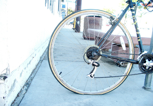 Flat tires are an inevitable part of biking, but can ruin your day if you're not prepared. Photo via 7-how-7.