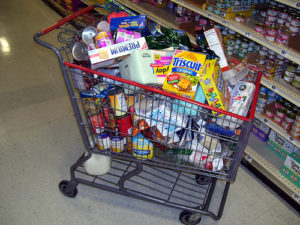 Shopping carts make us buy more stuff than we can carry home! Photo via phil_g