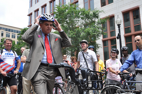U.S. Department of Transportation Secretary Ray LaHood mounts a demonstration bike from the new soon-to-be-named bike-sharing program in DC. Photo by Transportation for America