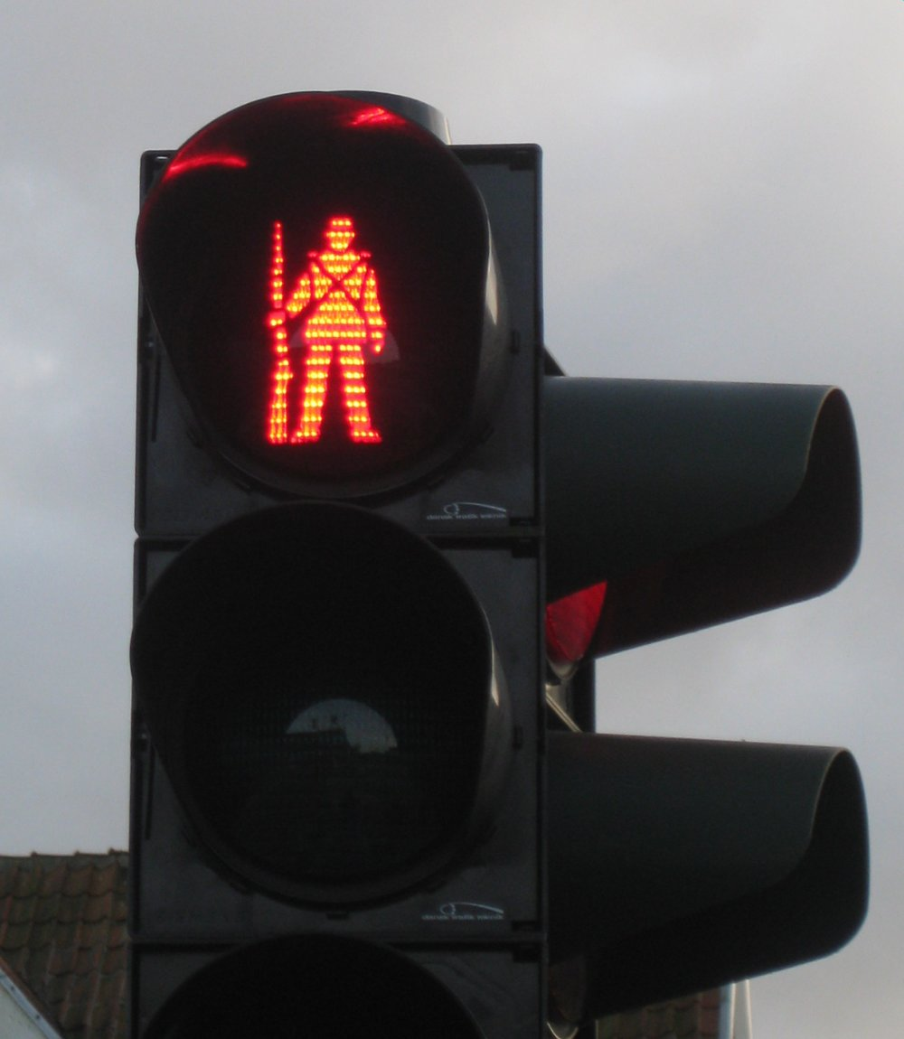For those who like men in uniforms: Fredericia, Denmark's pedestrian crossing features a uniformed foot soldier, with rifle in tote. He slings it over his shoulder to walk. Photo via Wikimedia Commons.