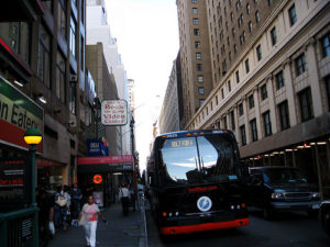 BoltBus rolls up into New York City. Photo by Somewhat Frank.