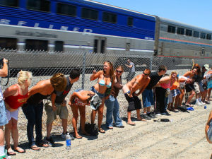 It happens only once a year! Participants flash some flesh at a passing Amtrak train.