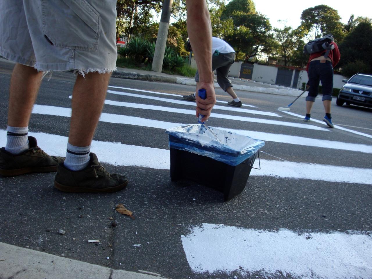 The 'urban repair squad' painted pedestrian a pedestrian crosswalk during the Brazil - North Korea World Cup match. Photo via ApocolipseMotorizado.