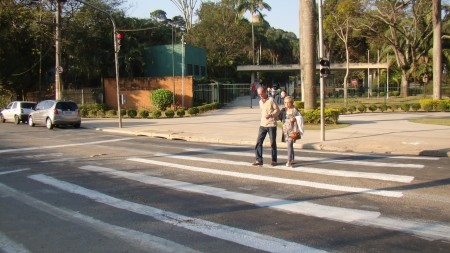 After: Pedestrians use the Urban Repair Squad's new crosswalk at the pelican crossing. Photo via Apocolipse Motorizado.