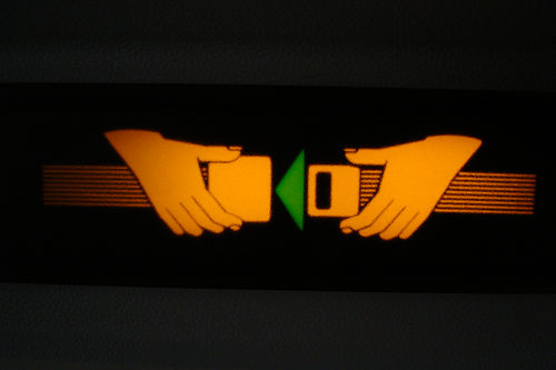 The federal government in the United States is considering mandating that seat belts be installed in large motorcoaches. Photo by Ti.mo