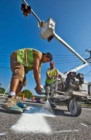 Installing a new HAWK pedestrian crossing on Route 72, on the University of Delaware campus. Image via Delaware Online.