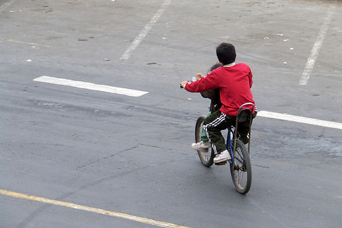 Kids bicycling in Lima, Peru. Photo by Luca