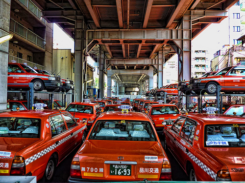 Each city deals with its own unique challenges of regulating taxis. Taxis in Tokyo. Photo by Altus.