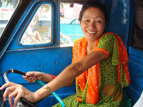 A female tuk-tuk driver in Kathmandu. Photo by Sirensongs.