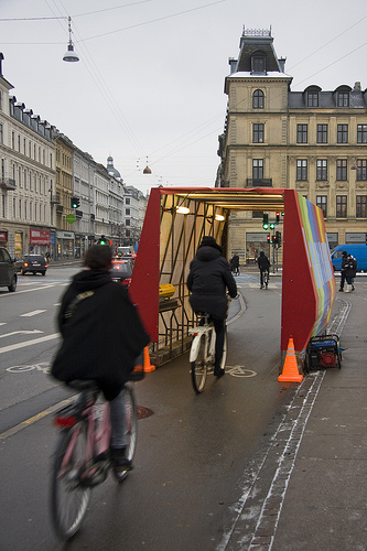 A rail service in Copenhagen, Danish State Railways, announced that bikes will now be free on train. They accompanied the announcment with a demonstration on one of the busiest streets in the county. Photo credit to Copenhagenize.com.