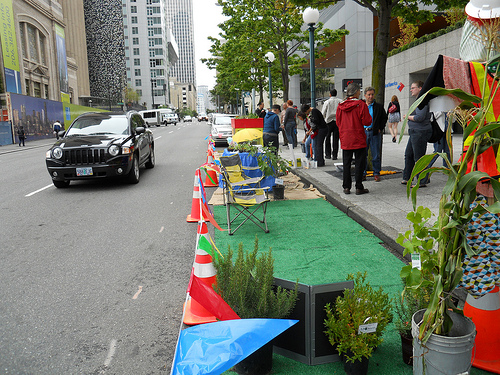 Re-envisioning spae allotted to cars in urban settings through PARK(ing) day. Photo by Allie Gerlach.
