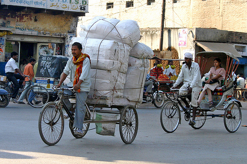 Load carrying bikes in Varanasi, India. Photo by dirk huijssoon.