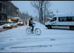 Many bikers are still charging despite winter weather. Image is a screen shot of a video by Alicia.