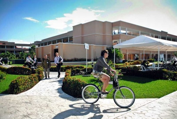 A woman bikes around the Moon Palace Hotel during the COP-16 meeting in Cancun. Photo via cc2010.mx.