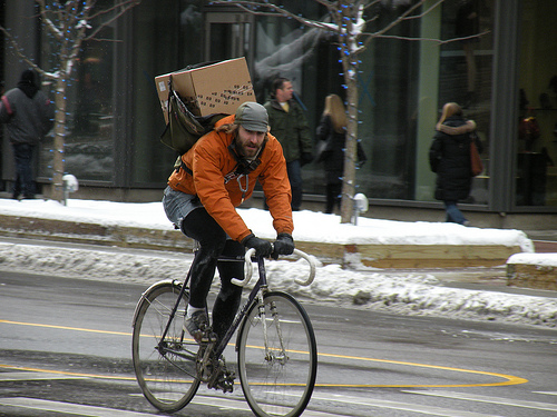 A Chicago man carries a heavy load through city streets. Photo by John W. Iwanski.