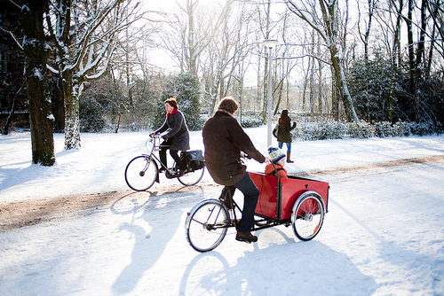 As long as you're bundled up, like this family in Amsterdamn, carting kids is a breeze. Photo by Bauke Karel.