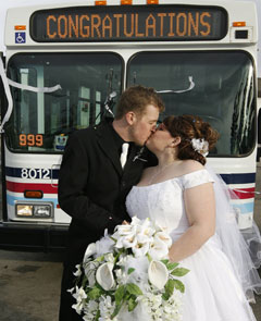 Amanda and Brendan Miles pose for wedding pictures in Calgary. Photo via CBC News.