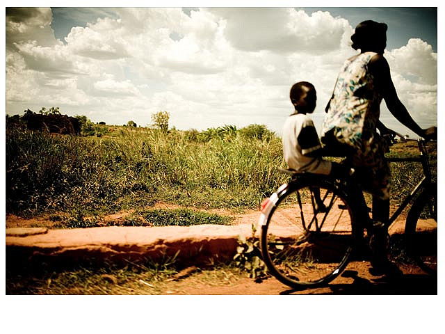 Women in Biwili, Uganda use bicycles as a form of transportation and economic development. Photo by Peter Reid