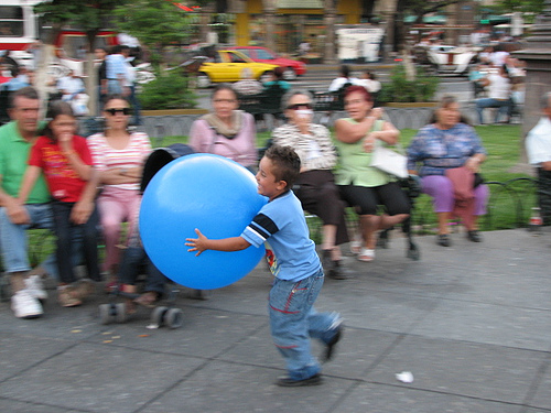 A child enjoys a public square in Guadalajara, Mexico. Photo by Captain Victor.