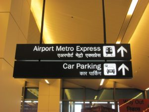 Billboards at IGI Airport (Terminal 3), showing connectivity to Airport Metro Express. Photo by Amit Bhatt.