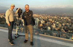 Filmmakers Luke Geissbühler and Gary Hustwit atop a heliport in Santiago, Chile. Photo via Urbanized.