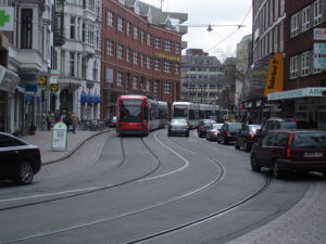 A tram winds down a street in Bremen, Germany. Photo by kaffeeeinstein.