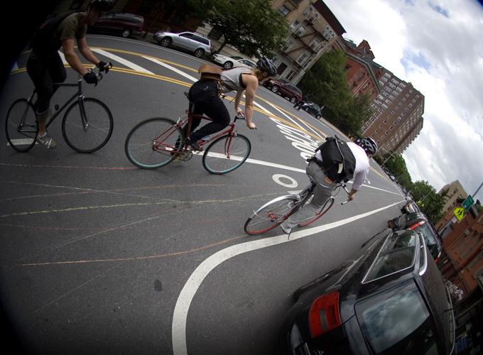 Contrail, a bicycle advocacy tool, uses chalk to line the path of bicycles. Photo via Bike Contrail