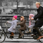 An Amsterdam family takes the cargo bicycle instead of the minivan. Photo by Marc van Woudenberg.