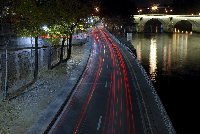 Cars zipping on the Seine Expressway in Paris. Photo by ~ Phil Moor.