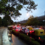 A cycle rickshaw breezes past evening congestion. Photo by V Malik.