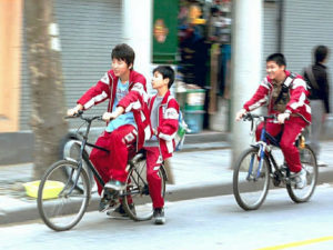 Cycling from school in Shanghai, China. Photo by badbrother.