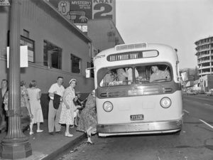 Passengers head southbound from Vine St. at Hollywood Blvd, July 1955. Photo by Metro Transportation Library and Archive.