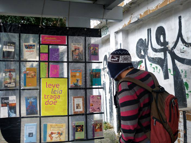 A passenger peruses a book stop in Brazil