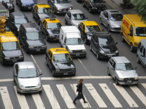 Chronic traffic congestion is one of many negative impacts resulting from an urban reliance on private automobiles. Photo by Mike Wegner.