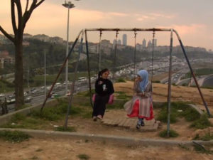 """Two girls are cut off from the rest of their city by large highways and poor public transport. Image from """"Overdrive."""""""