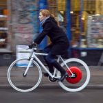 A bicyclist cruises using the new Copenhagen Wheel. This design, a project of the MIT SENSEable City Lab and distributed by Superpedestrian, replaces the rear wheel of a bicycle with a battery-powered motor, transforming an ordinary bicycle into a hybrid e-bike. Photo by Max Tomasinelli.