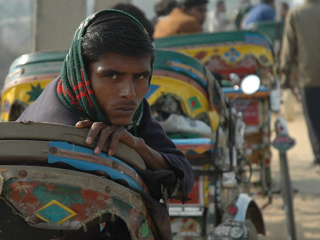 Cycle rickshaw driver in Gurgaon, India